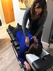 Dr. Erin Anderson chiropractic on patient